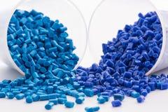 2 blue dyed polymer resins Stock Photos