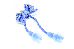 Blue earplugs with a string on white background. Stock Photo