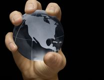 Blue Earth. Male hand holding glass globe Royalty Free Stock Photo