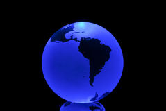 The Blue Earth. The blue planet, centered in south america, isolated in black royalty free stock photo