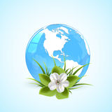 Blue earth globe with flower. Blue globe in grass with flower and grass, illustration Stock Image