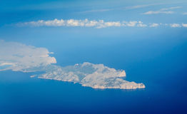 Blue Earth Mallorca. Blue Mediterranean sea and sky melt together in morning light. In-flight aerial view of Cap Formentor, north Mallorca, Balearic islands Royalty Free Stock Image