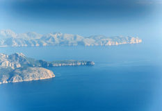 Blue Earth Mallorca. Misty blue morning bird's eye aerial view north Mallorca with Formentor peninsula and lighthouse. Mallorca, Balearic islands, Spain Stock Image
