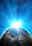 Blue earth in space. With rising sun Stock Photos