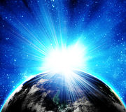 Blue earth in space. With rising sun Royalty Free Stock Photos