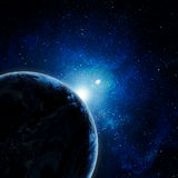 Blue earth in space. With rising sun Royalty Free Stock Images