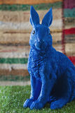 Blue easter bunny ornament on grass. With textured background Royalty Free Stock Photography
