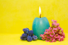Blue easter cande with   flowers Stock Photo