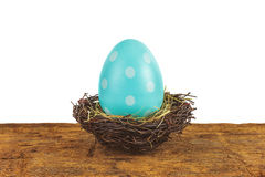 Blue easter egg on a wooden table isolated on white stock images