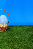 Blue Easter eggs in the basket Royalty Free Stock Photos