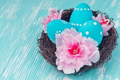 Blue Easter eggs in nest Royalty Free Stock Photos