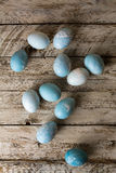 Blue Easter Eggs on rustic wood, overhead view Royalty Free Stock Photography
