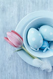 Blue Easter Eggs in a Tea Cup Royalty Free Stock Photo