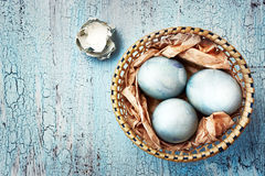 Blue easter eggs on a textured background. Ru Royalty Free Stock Images