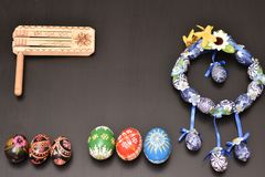 Blue easter garland with colored eggs. Blue easter garland with six colored eggs on a black table Royalty Free Stock Image