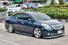 Blue ECO Car Sedan in VIP Style. BANGKOK, THAILAND - JULY 7, 2014 : NISSAN ALMERA, an ECO Car SEDAN in Thailand, is being posted in one of Thailand magazine to Royalty Free Stock Photos