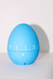 Blue egg timer in front of white background Royalty Free Stock Photography