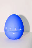 Blue egg timer in front of white background Royalty Free Stock Photos