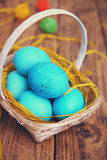 Blue eggs in the basket, tinted Royalty Free Stock Images