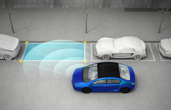 Blue electric car driving into parking lot with parking assist system Stock Images
