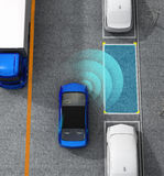 Blue electric car driving into parking lot with parking assist system Royalty Free Stock Photography