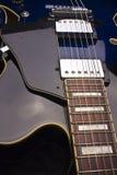 Blue Electric Hollow Body Guitar. Close up of a Blue Hollow Body Electric 6-String Guitar royalty free stock photos