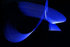 Blue electric light painting, long exposure photography, ripples and waves pattern against a black background. Blue electric Light Painting Photography, parallel stock photos