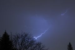 Blue electricity. Night lightning storm Royalty Free Stock Photos