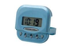 Blue electronic alarm clock isolated Royalty Free Stock Photography