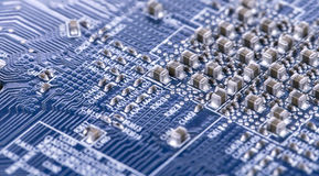 Blue electronic circuit board Stock Images