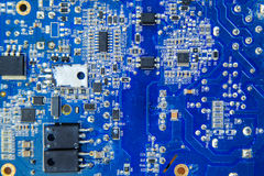 Blue electronic circuit board close-up with different microeleme. Electronic circuit board close-up with different microelements Royalty Free Stock Images