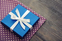 Blue elegant gift box. On a wooden background Stock Images