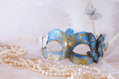blue elegant venetian mask next to pearls Stock Image