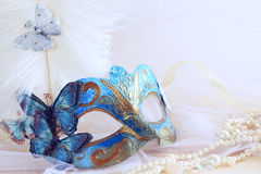 blue elegant venetian mask next to pearls Royalty Free Stock Photography