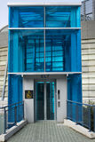 Blue Elevator. A blue elevator at a sports ground. The elevator has a disabled sign on it stock photography