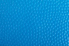 Blue embossed dots for background. Or wallpaper stock image