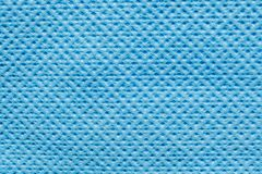 Embossed Texture of Synthetic Fiber Fabric, close-up abstract background. Blue Embossed Texture of Synthetic Fiber Fabric, close-up abstract background stock images