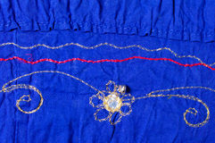 Blue embroidered fabric Royalty Free Stock Photo