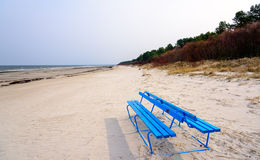 Blue empty bench near the Baltic sea in Jurmala, Latvia Stock Photo