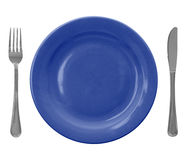 Blue empty plate with fork and knife. Isolated over white background royalty free stock photo