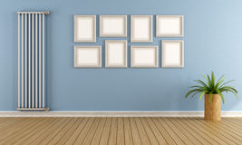 Blue empty room with vertical radiator Stock Photos