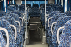 Blue empty seats in the bus Royalty Free Stock Image