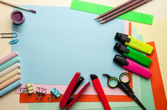 Blue empty sheet with stationery objects. Royalty Free Stock Photo