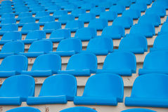 Blue empty stadium seats. In a row Stock Image