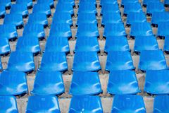 Blue empty stadium seats in arena. Old and dirty  concept Royalty Free Stock Image