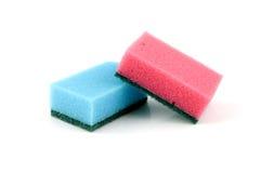 Blue en pink sponge. Isolated on white background stock images