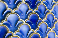 Blue enameled geometrical ornament royalty free stock image