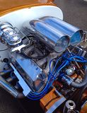 Blue engine. Exposed engine of a classic hot rod Royalty Free Stock Image