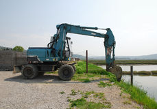 Blue Engineering Vehicle. A blue engineering vehicle by the side of an area of salt flats in Slovenia stock photography