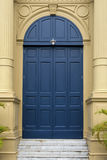 Blue entrance door in front Royalty Free Stock Photography